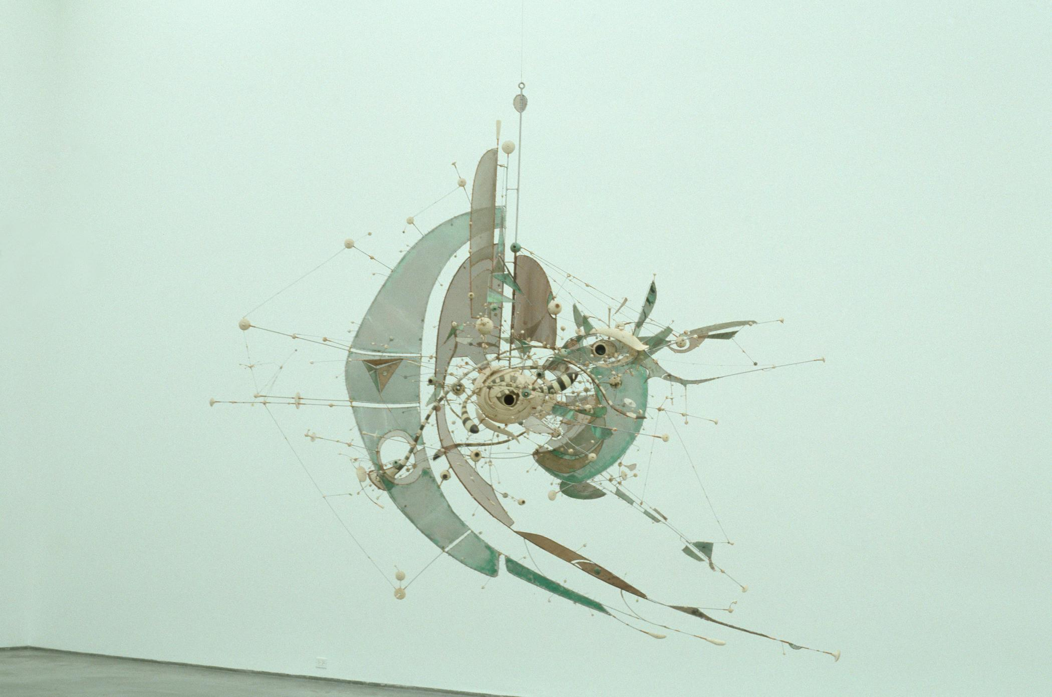 A suspended mixed-media sculpture with wire and steel sheets