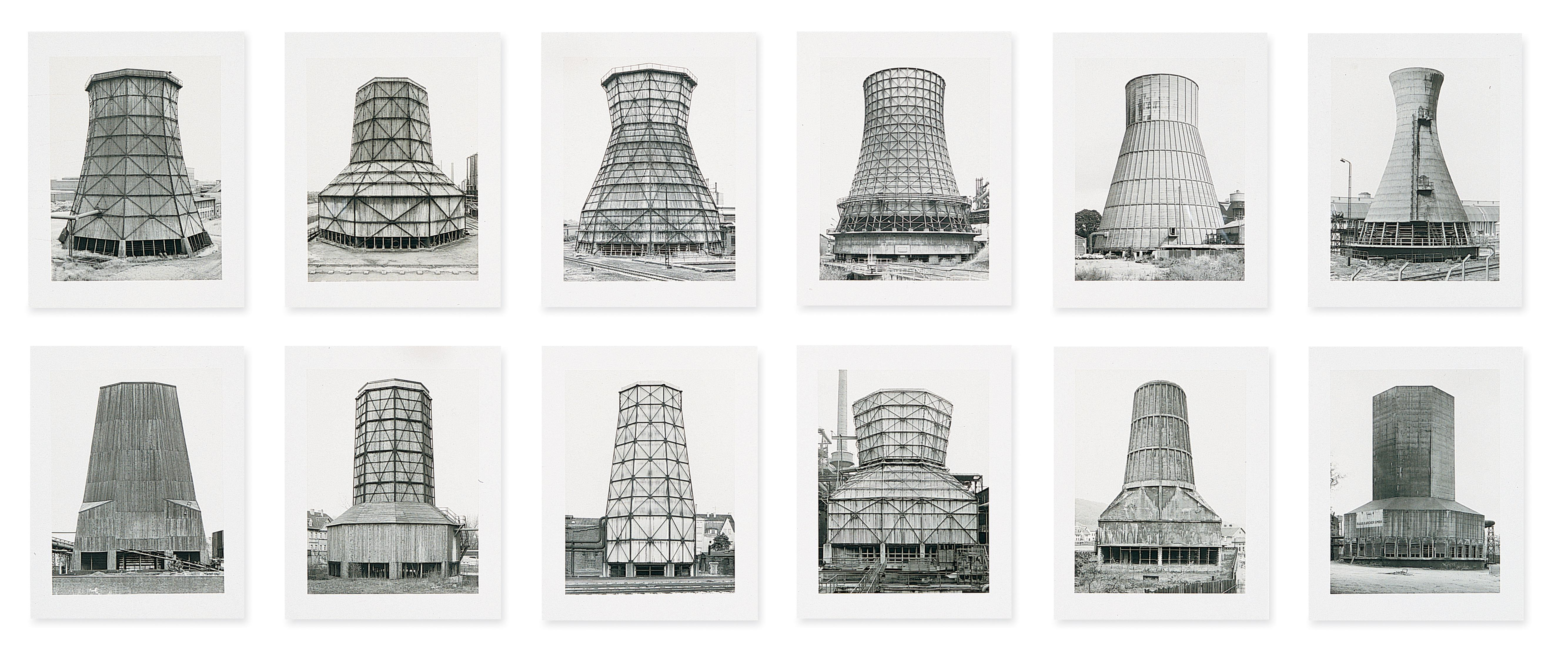 Black-and-white photographs of twelve cooling towers hung in two horizontal rows