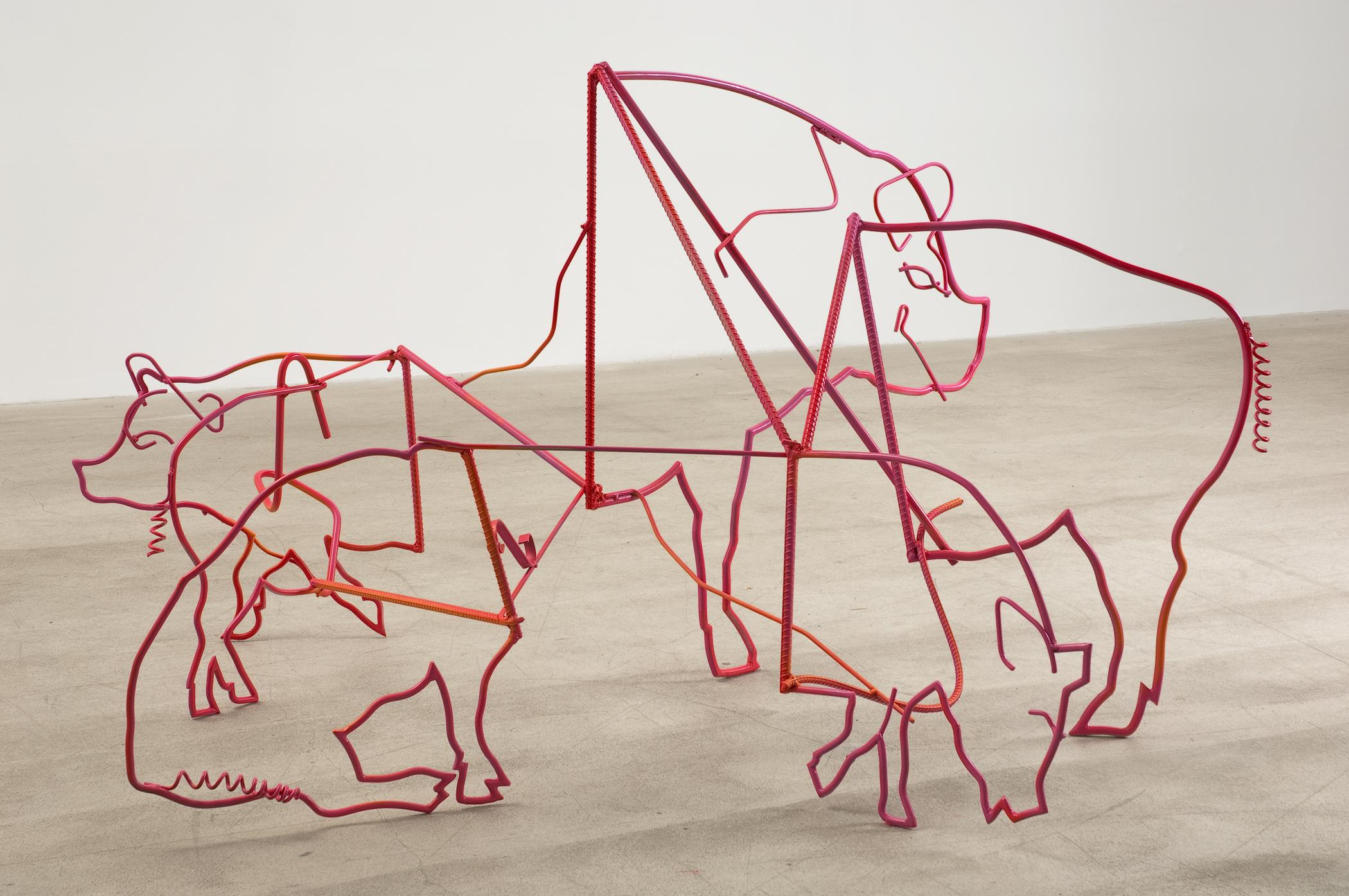An abstract sculpture depicts five overlapping red pigs.