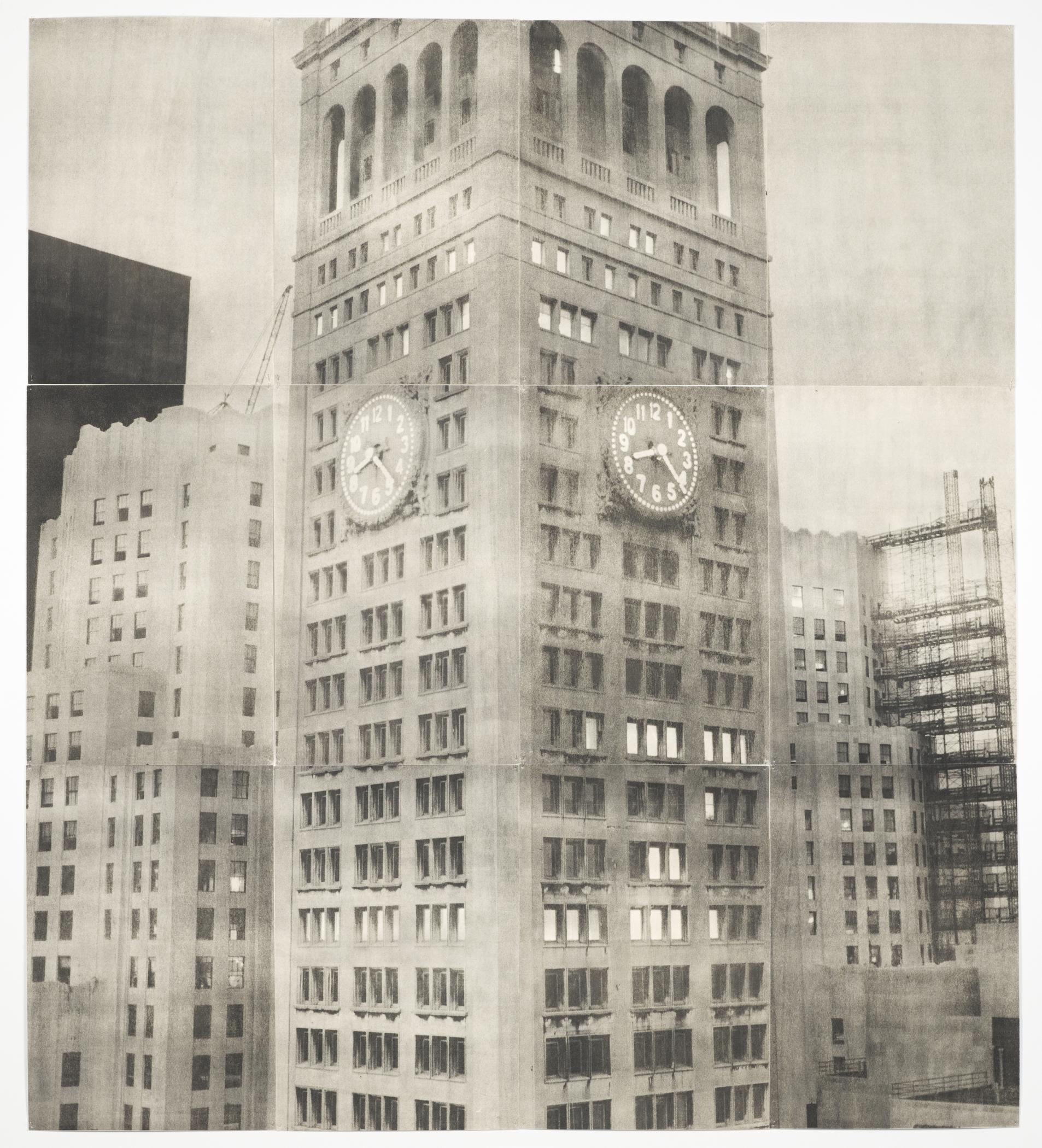 A black-and-white photo shows a clock tower among city buildings.