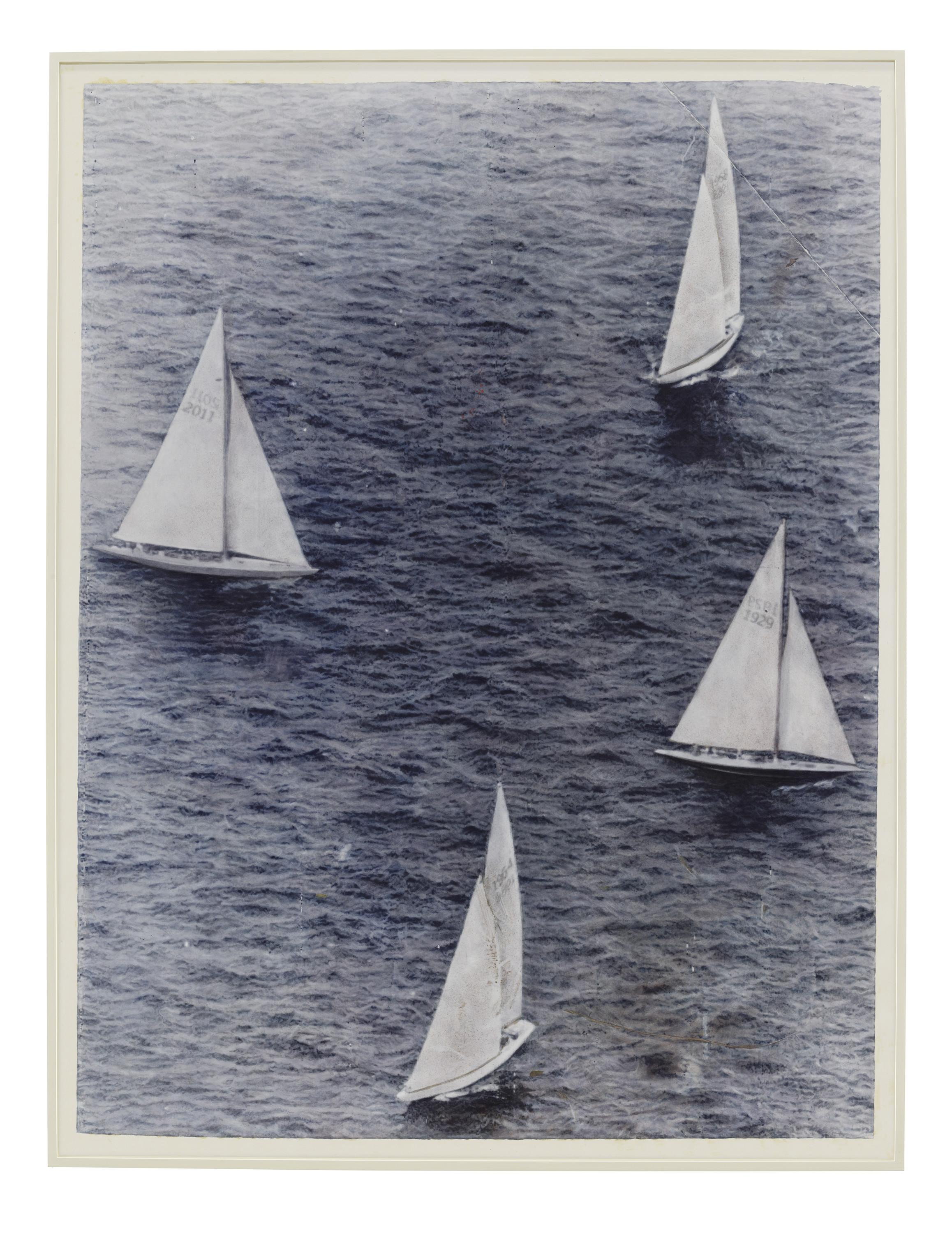 A faded black-and-white photograph shows four sailboats sailing in close proximity.