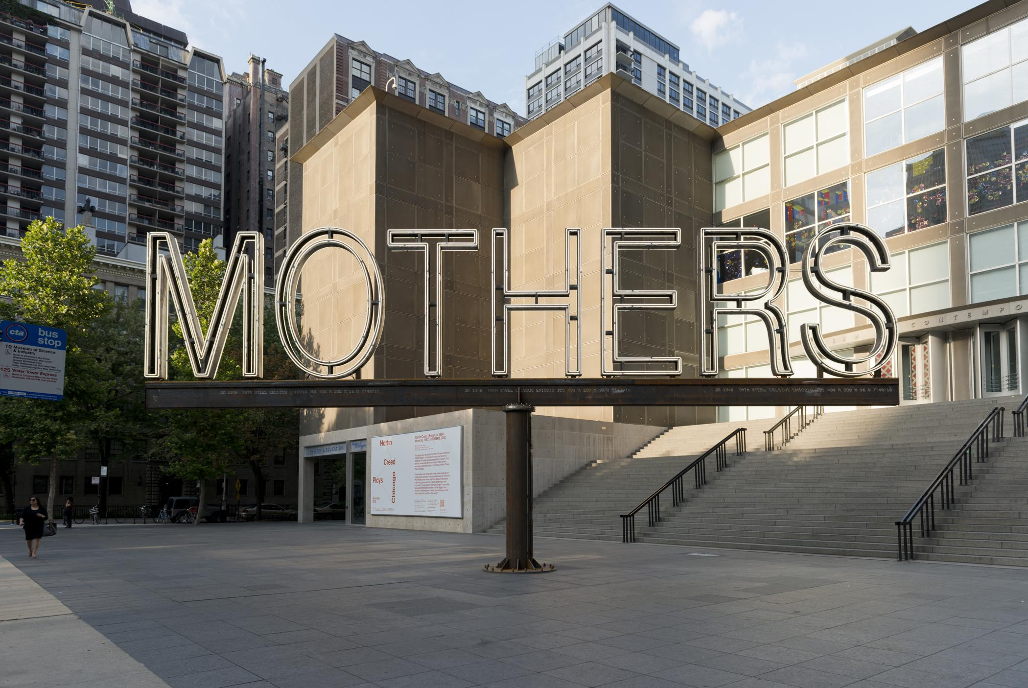"""A white neon and steel sign says """"MOTHERS."""""""