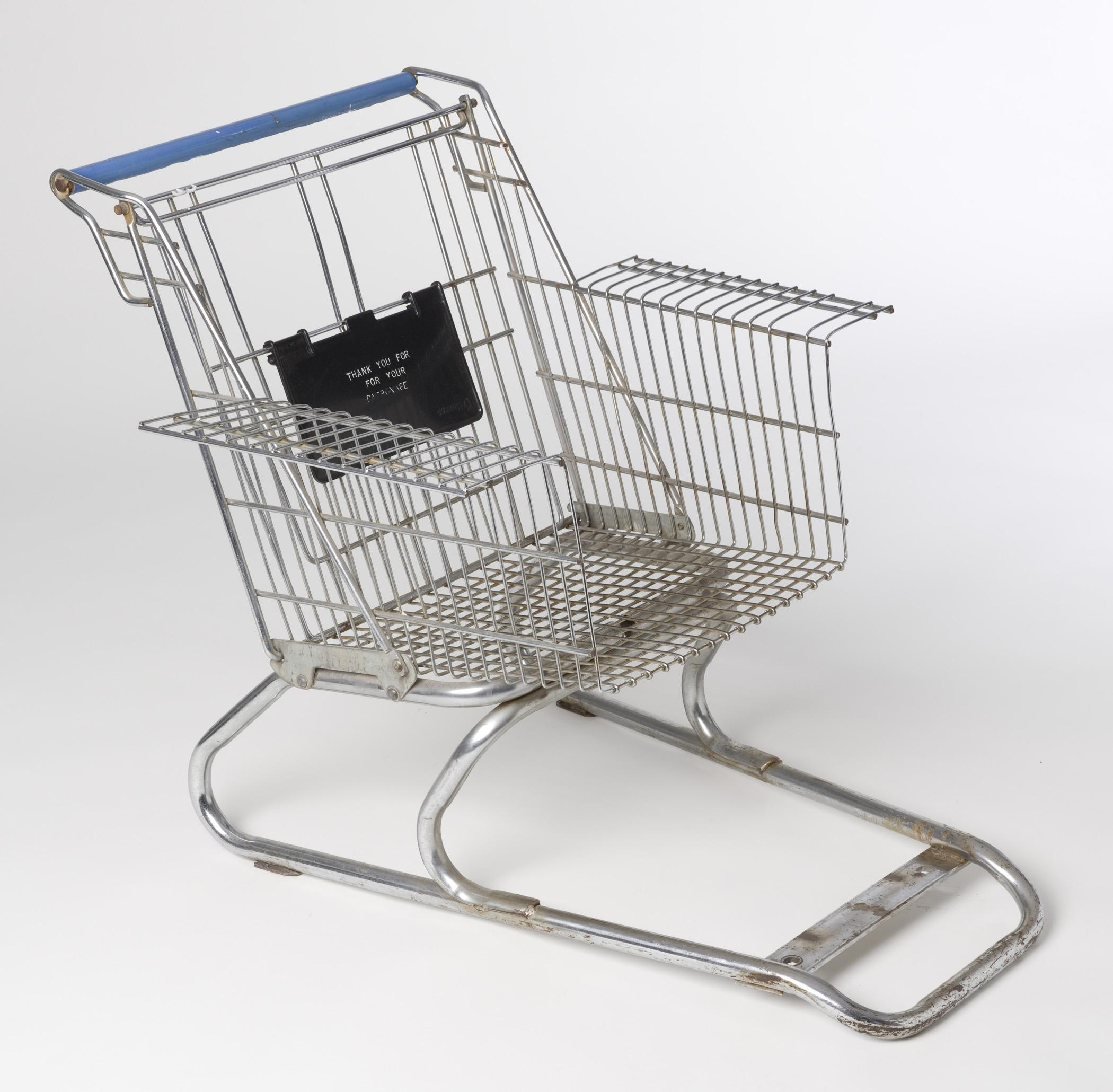 A metal grocery cart without wheels has been modified for use as an arm chair.