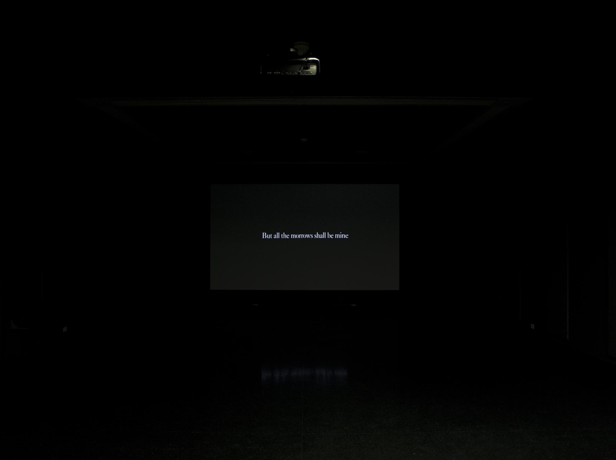 """A black screen that bears white text reads """"But all the morrows shall be mine."""""""