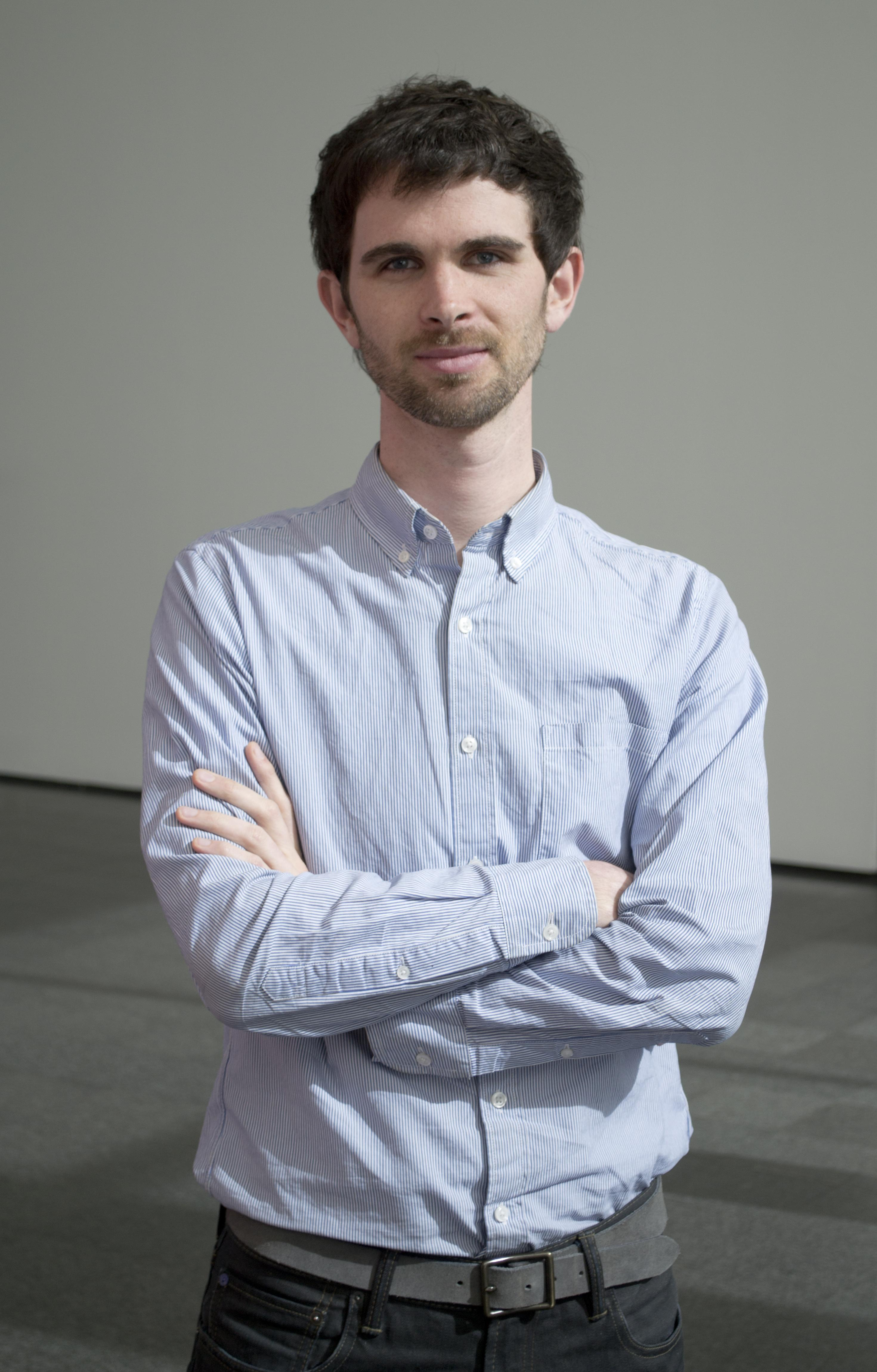 Portrait of MCA curatorial assistant Karsten Lund folding his arms