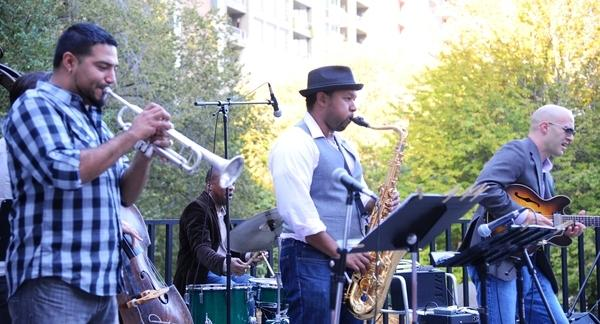 Five jazz musicians perform on the MCA terrace.