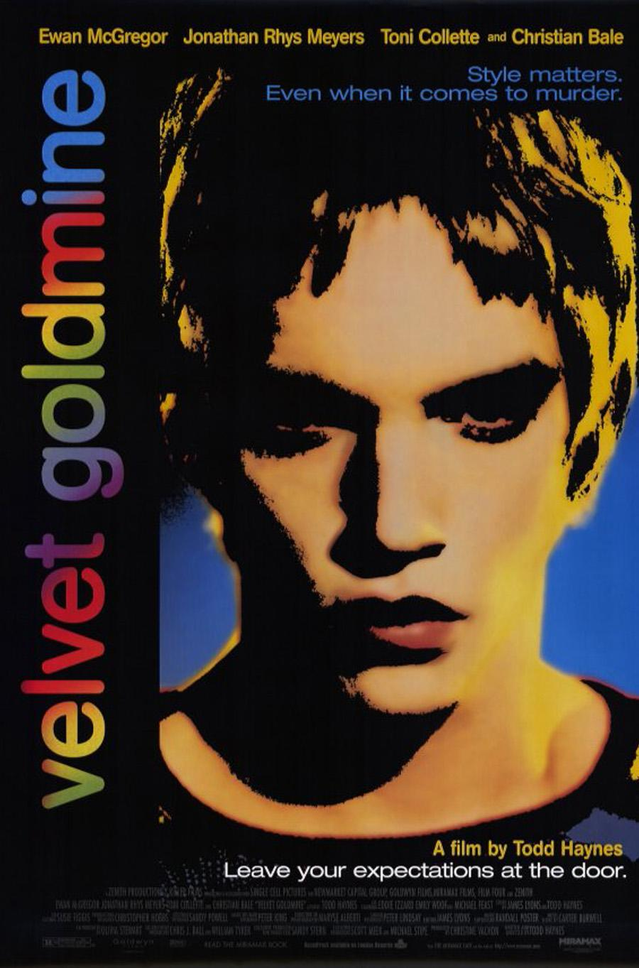 """A graphic poster for a movie starring Ewan McGregor, the portrait of a man in highly saturated colors and jet black shadows with """"velvet goldmine"""" in rainbow colors"""