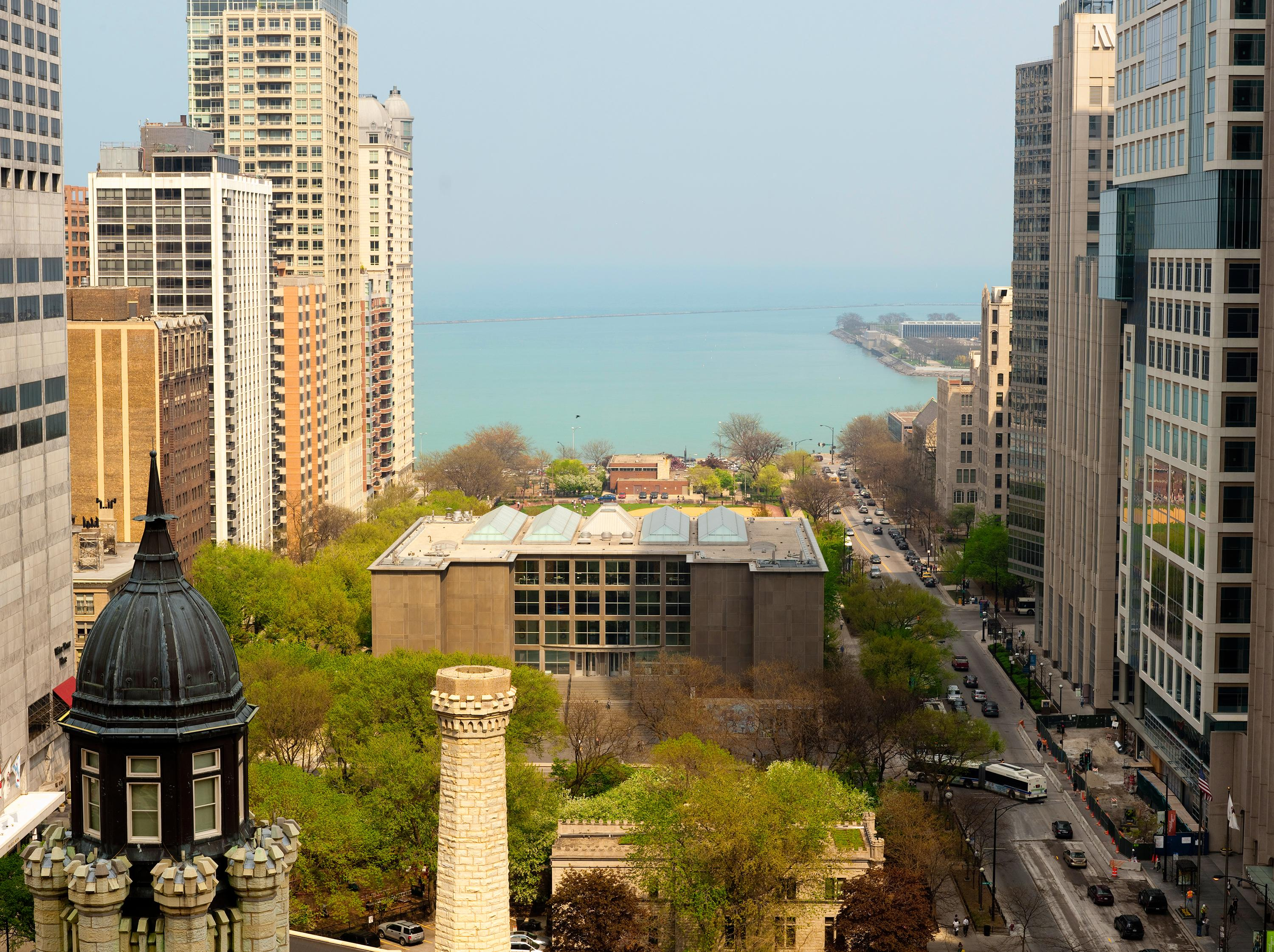 An aerial photograph captures views of the MCA, Lake Michigan, and surrounding buildings.