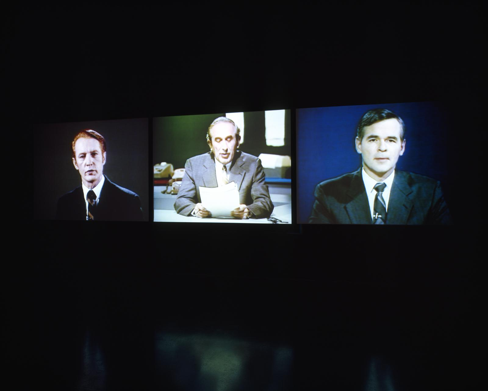 Three side-by-side screens show three different light-skinned men in suits. The men appear to be verbally addressing their audience.