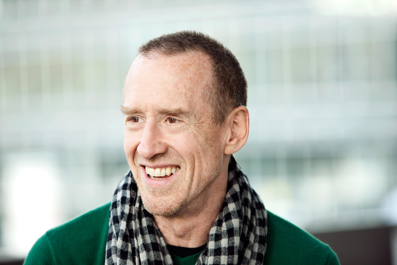 Close-up photo of smiling man