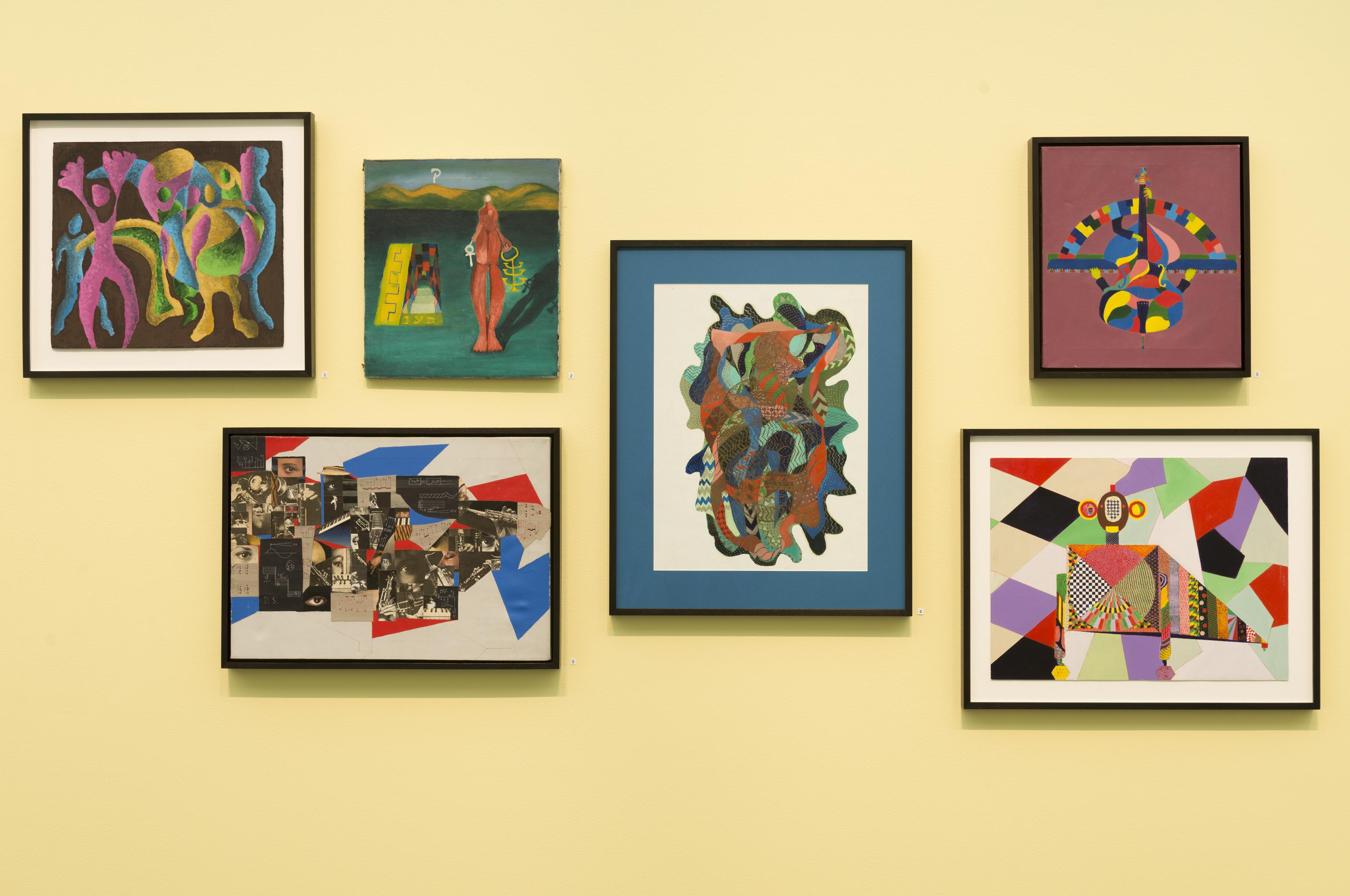 Six colorful paintings featuring geometric forms in bright colors are hung in a cluster on a yellow wall.