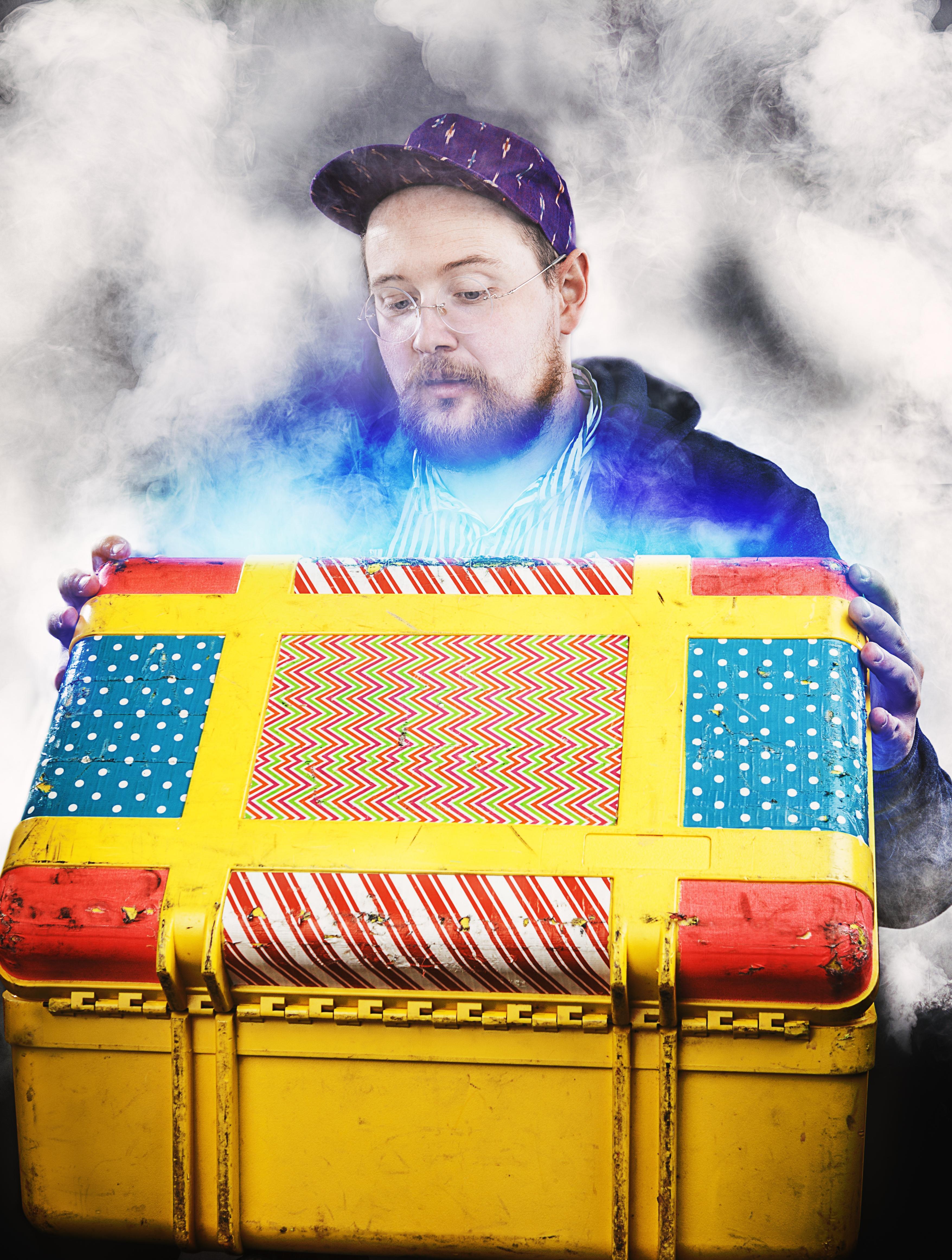 Photo of white smoke engulfing man looking in a box