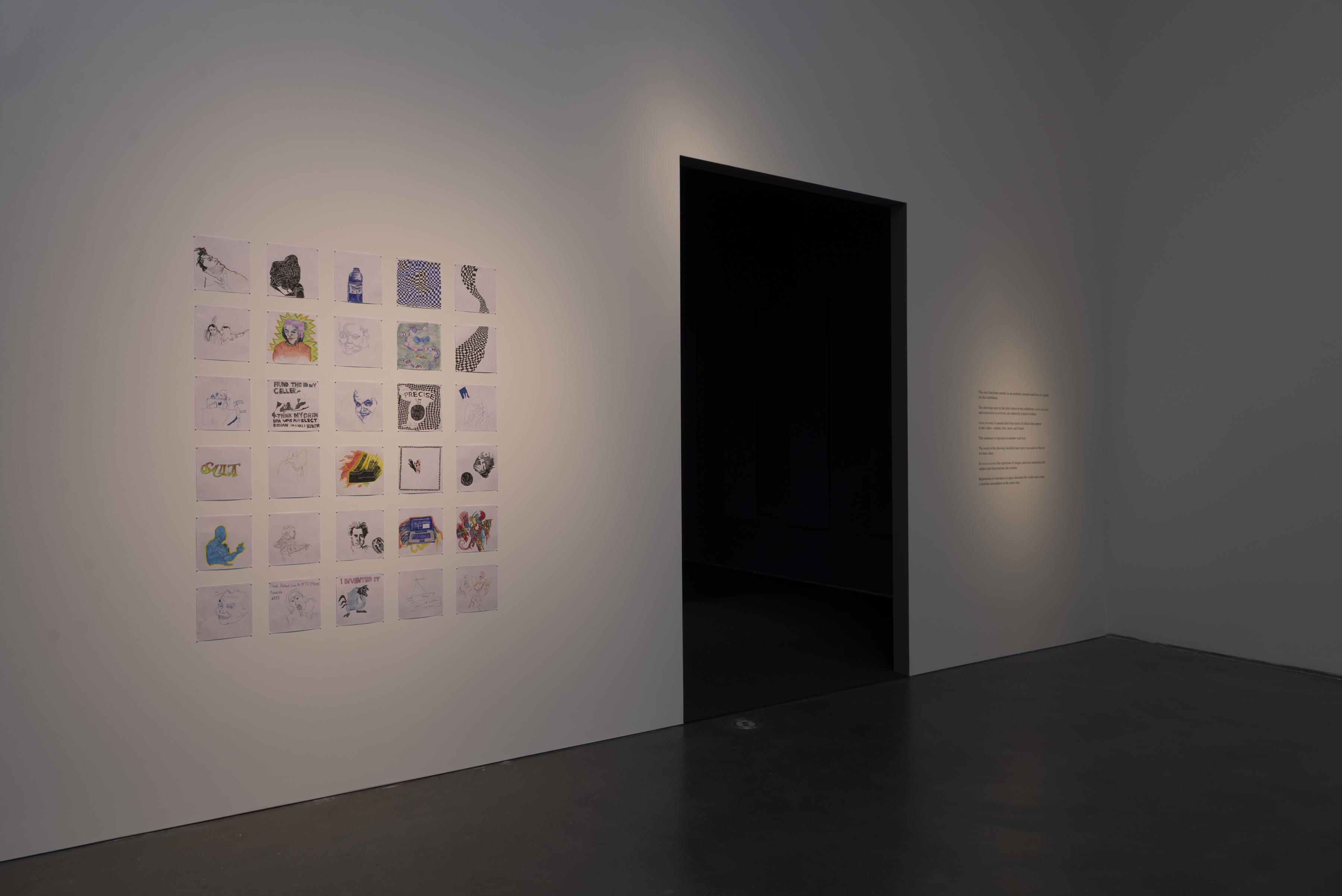 A six-by-five grid of square drawings next to a tall black rectangular doorway