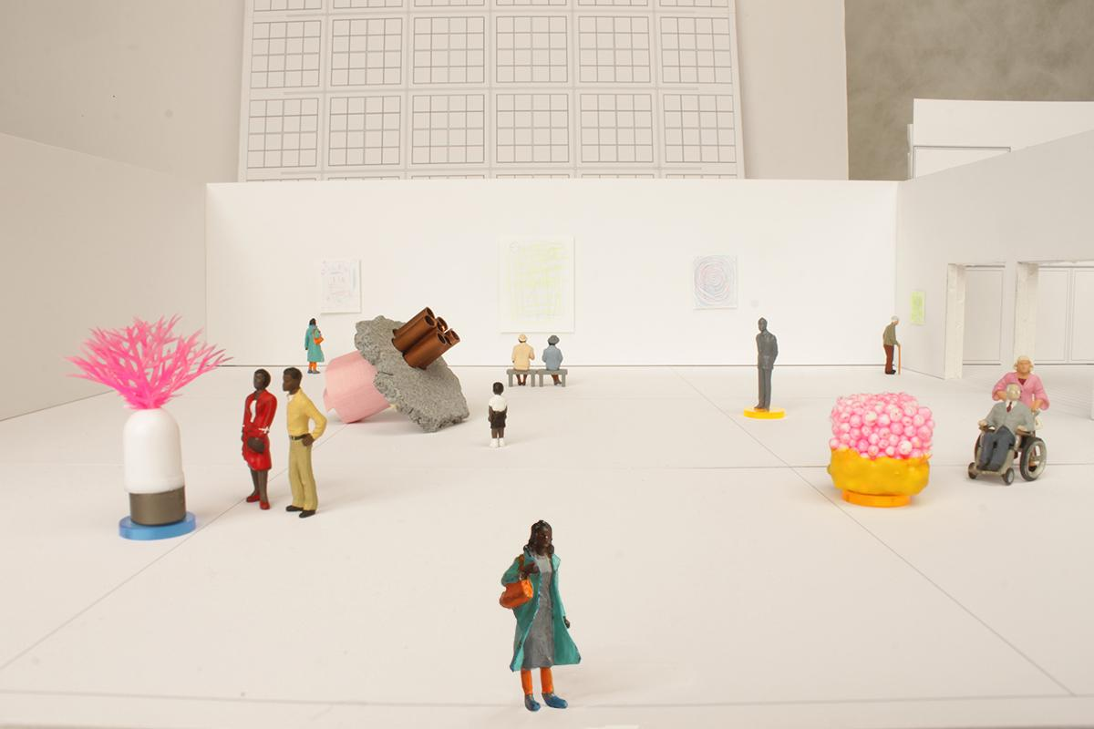 A black-and-white model of an MCA gallery with colorful figurines of people and artworks.
