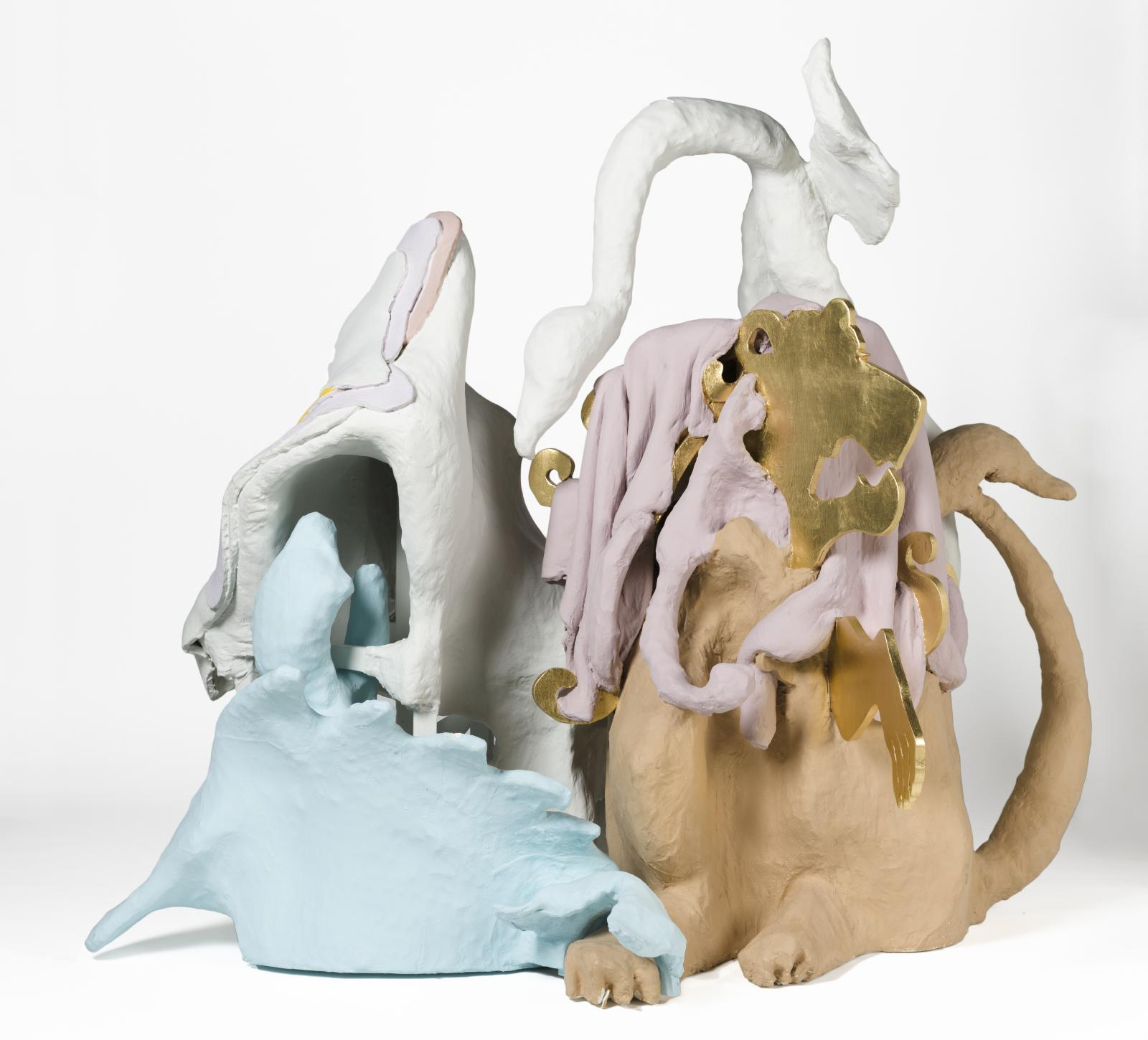 A sculpture that appears to be made of light blue, tan, gray, mauve, and white clay. It is shaped into animal-like forms like paws and tails, but remains abstract.