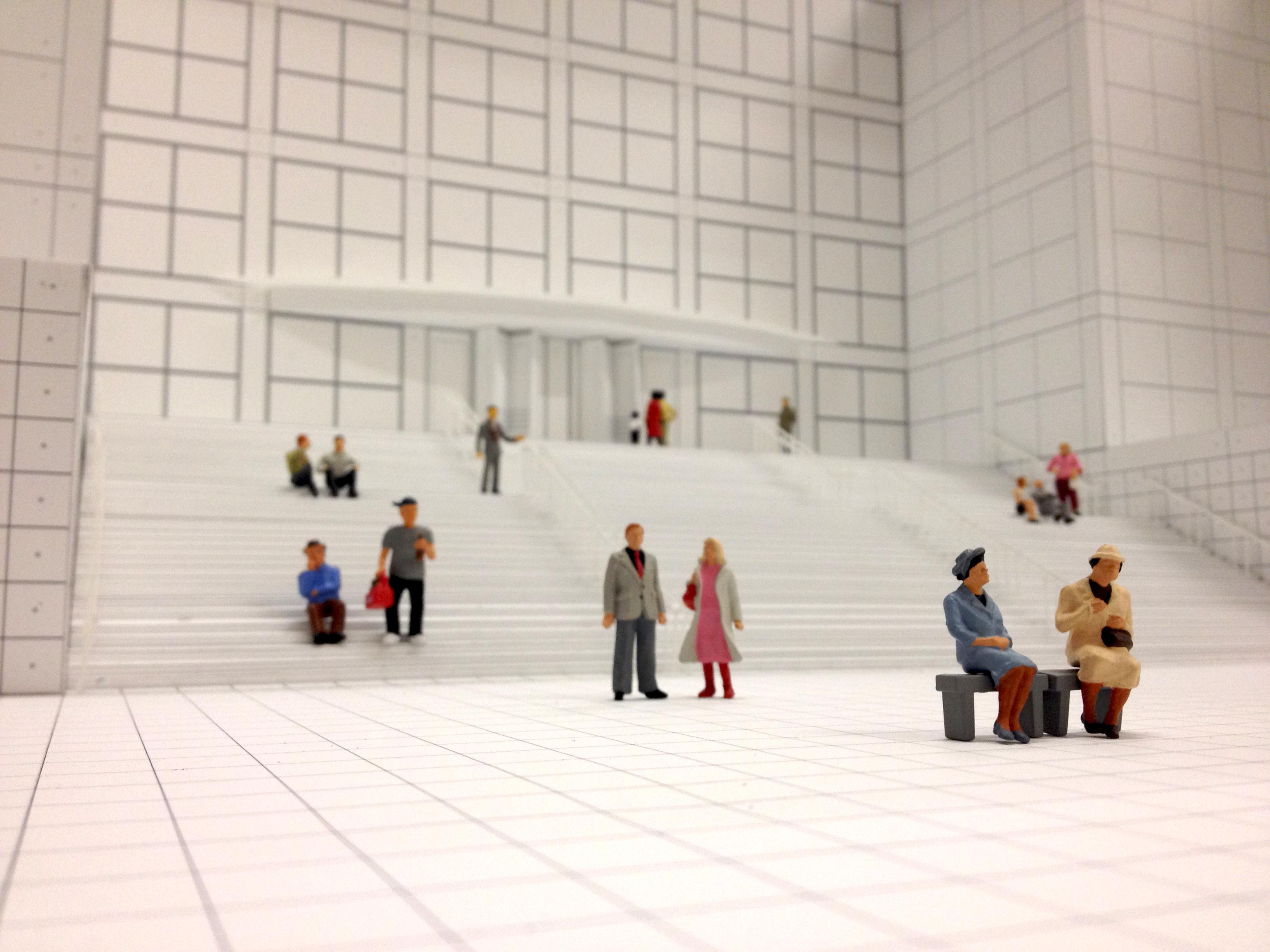 A black-and-white model of the MCA's front staircase and plaza with colorful figurines