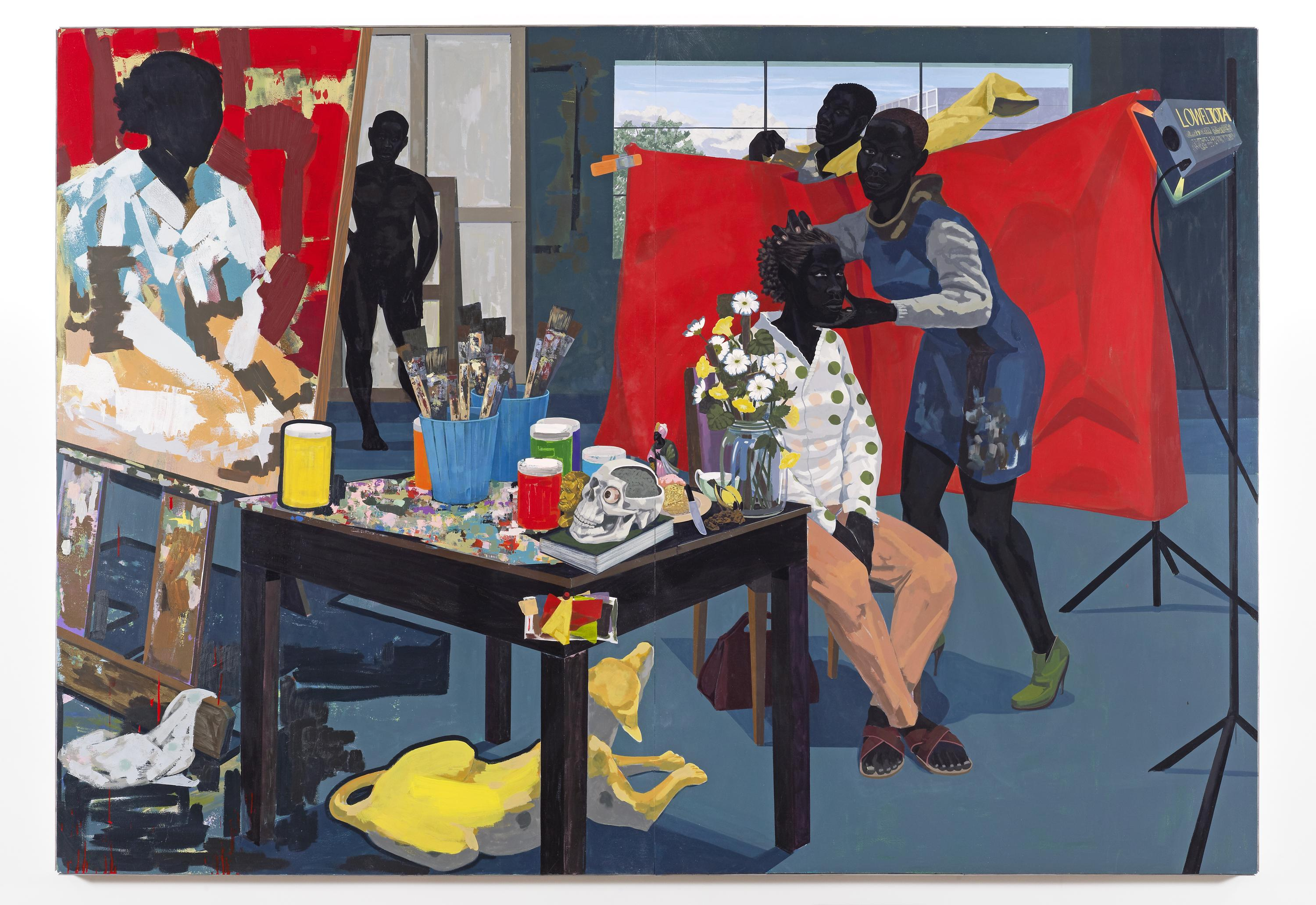 A black woman poses in a chair against a vivid red backdrop while a woman adjusts her head and a man gets dressed behind the backdrop. The painted portrait in progress is shown on an easel at left, next to a table strewn with paints and paintbrushes, a skull, and vase with flowers. A yellow dog rests on the floor below the table. A nude figure stands in the background.