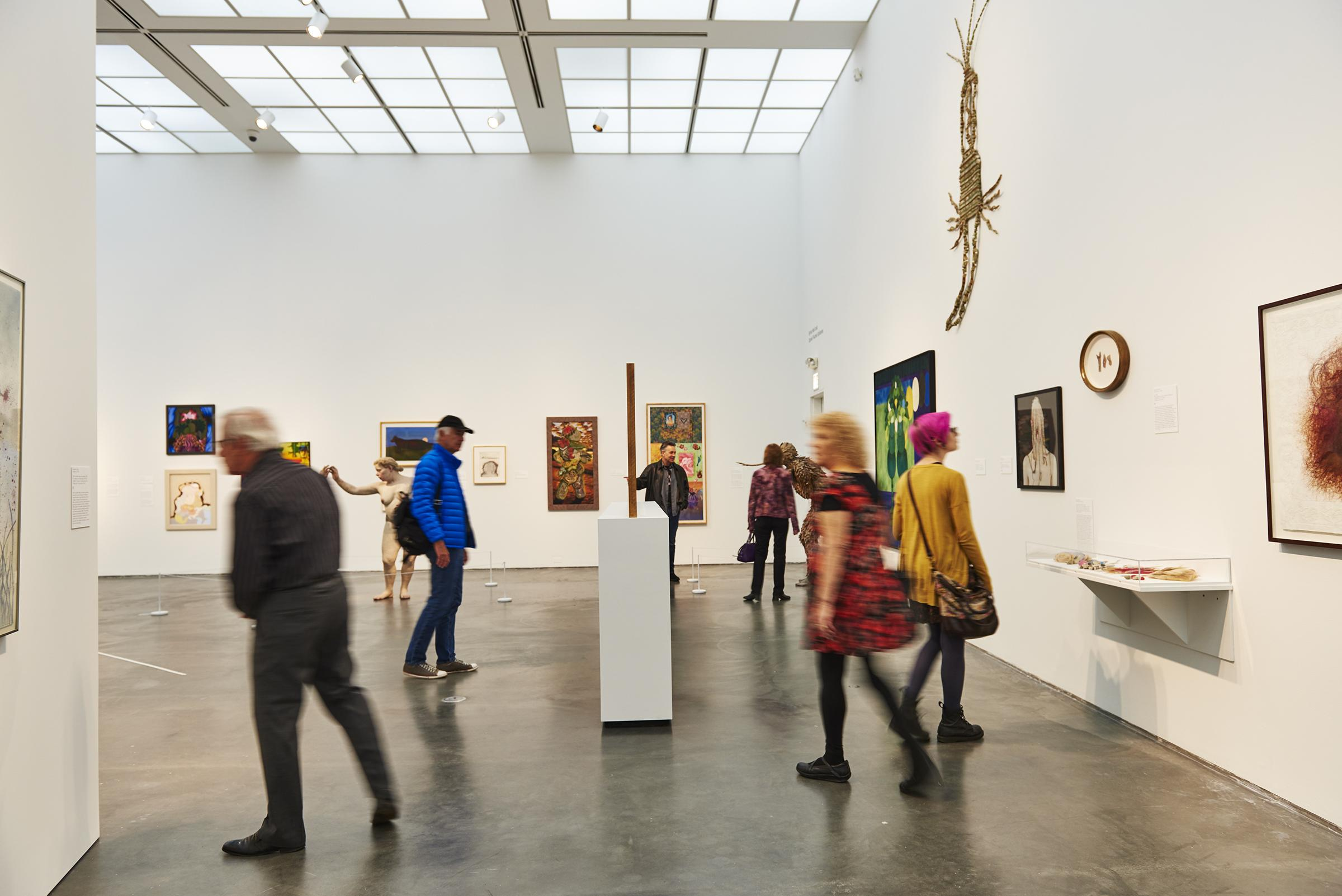 Visitors take in art in a gallery on the MCA's second floor.