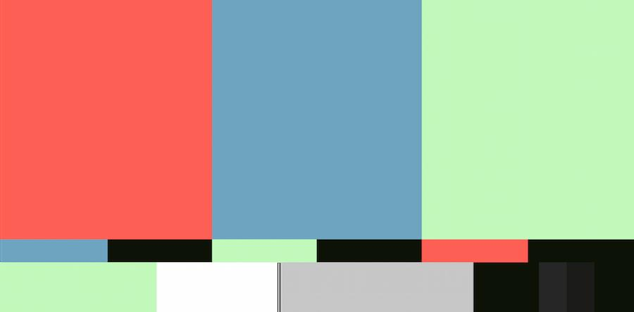 Muted multicolored rectangle shapes in reds, blues, and greens.