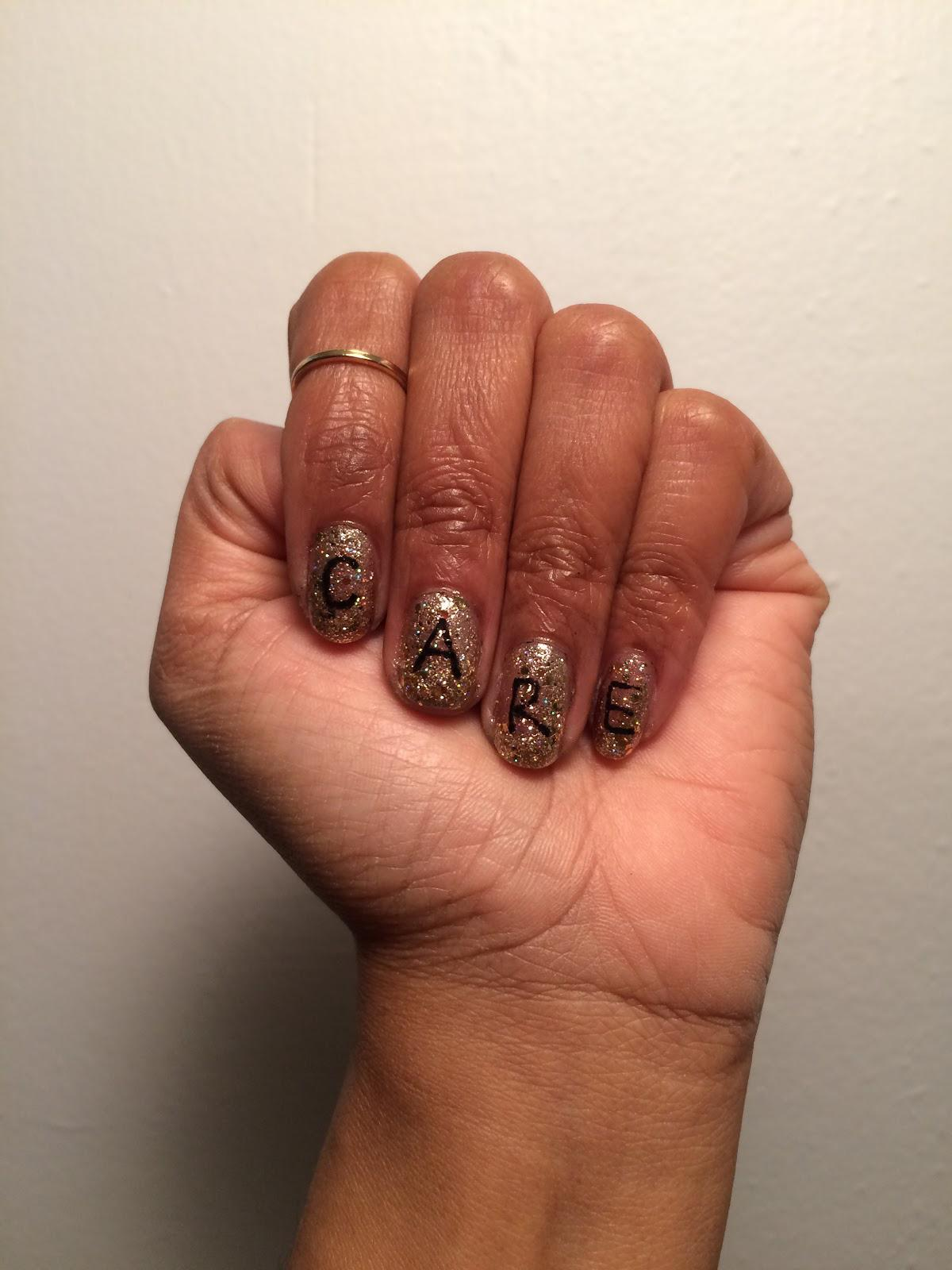 """The word """"CARE"""" is spelled out in black letters on gold glitter nail polish on four fingernails of a person's left hand, shown in a fist."""