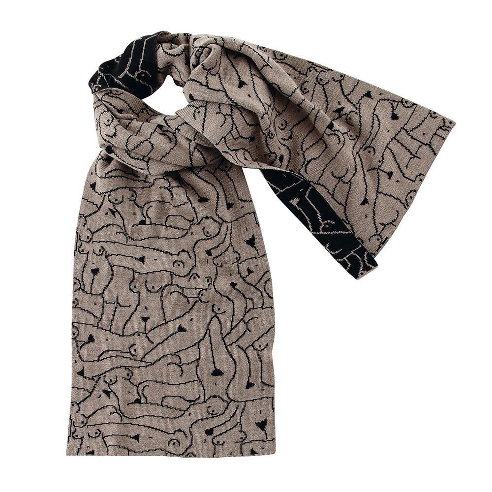 A knit scarf has an all-over design of the outlines of nude women's bodies in black lines on a beige background on one side, and beige outlines on a black background on the other. The scarf is tied in a loose knot.