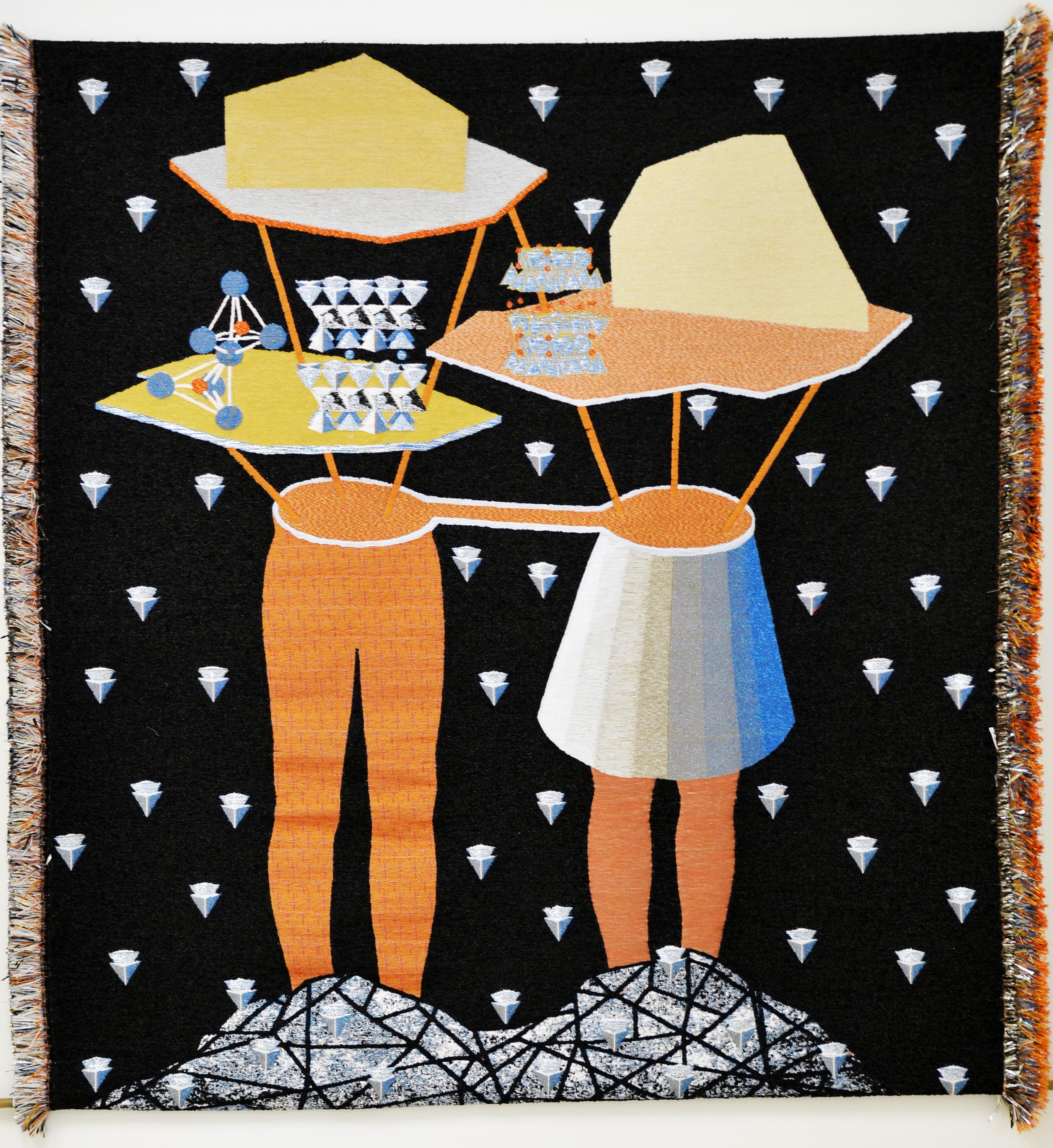 A black tapestry speckled with silver arrowheads depicts two pairs of orange legs, one wearing a skirt, with flat, geometric shapes in place of torsos and heads. The pair is connected at the hip and each stands on a crystalline mound.