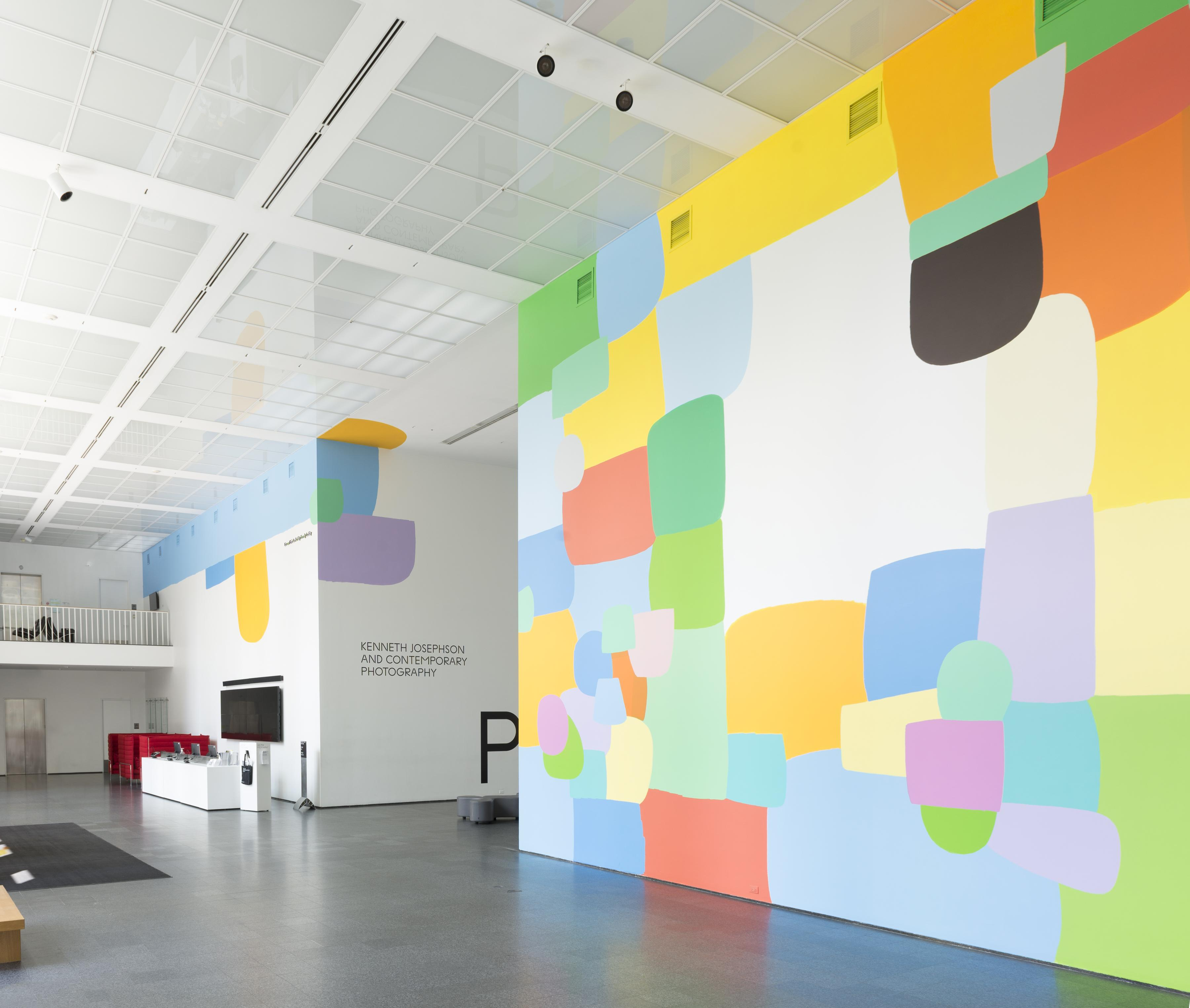 The MCA Atrium features a prominent, colorful mural on multiple walls.