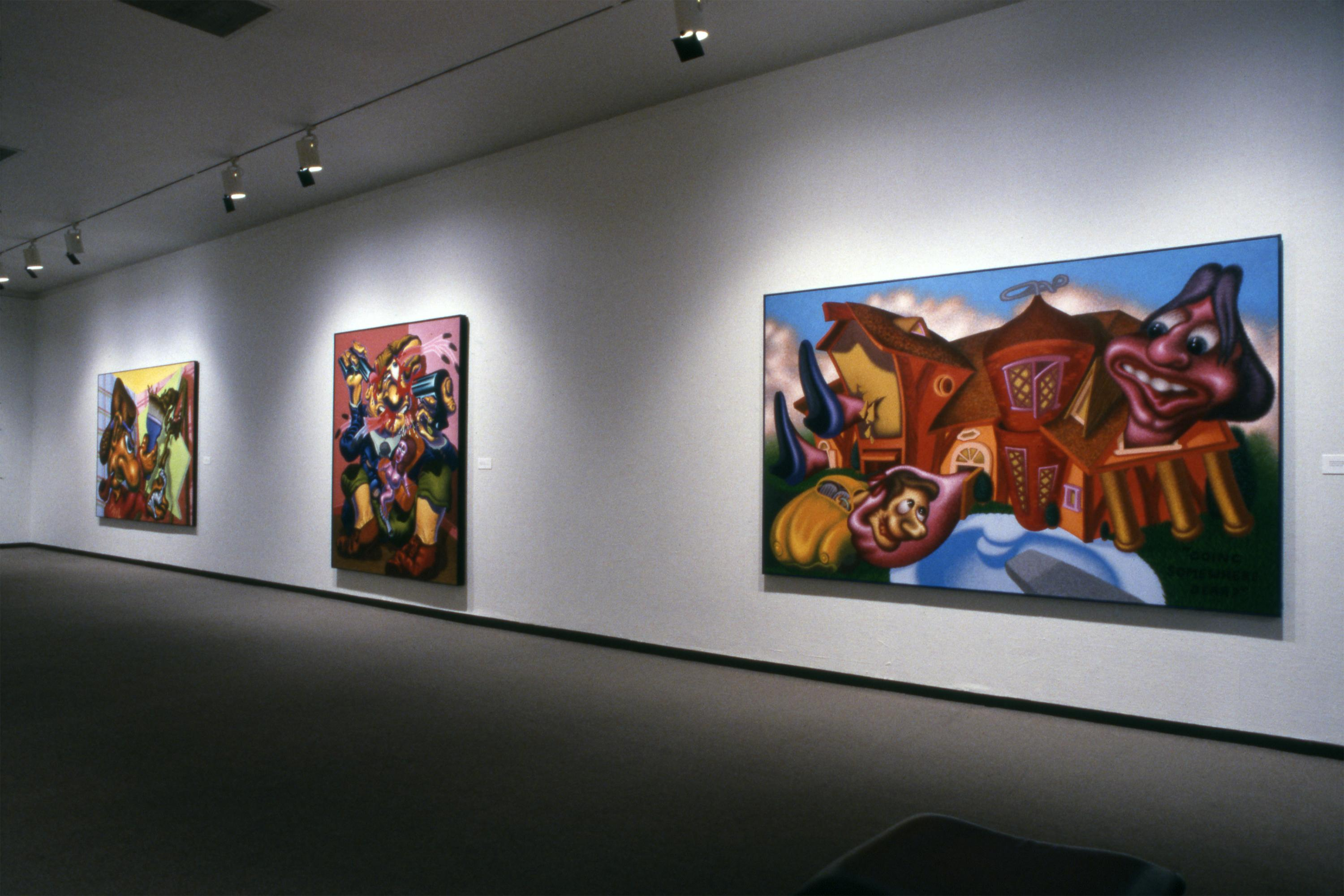 Three large, colorful paintings hang on a dramatically lit white wall.