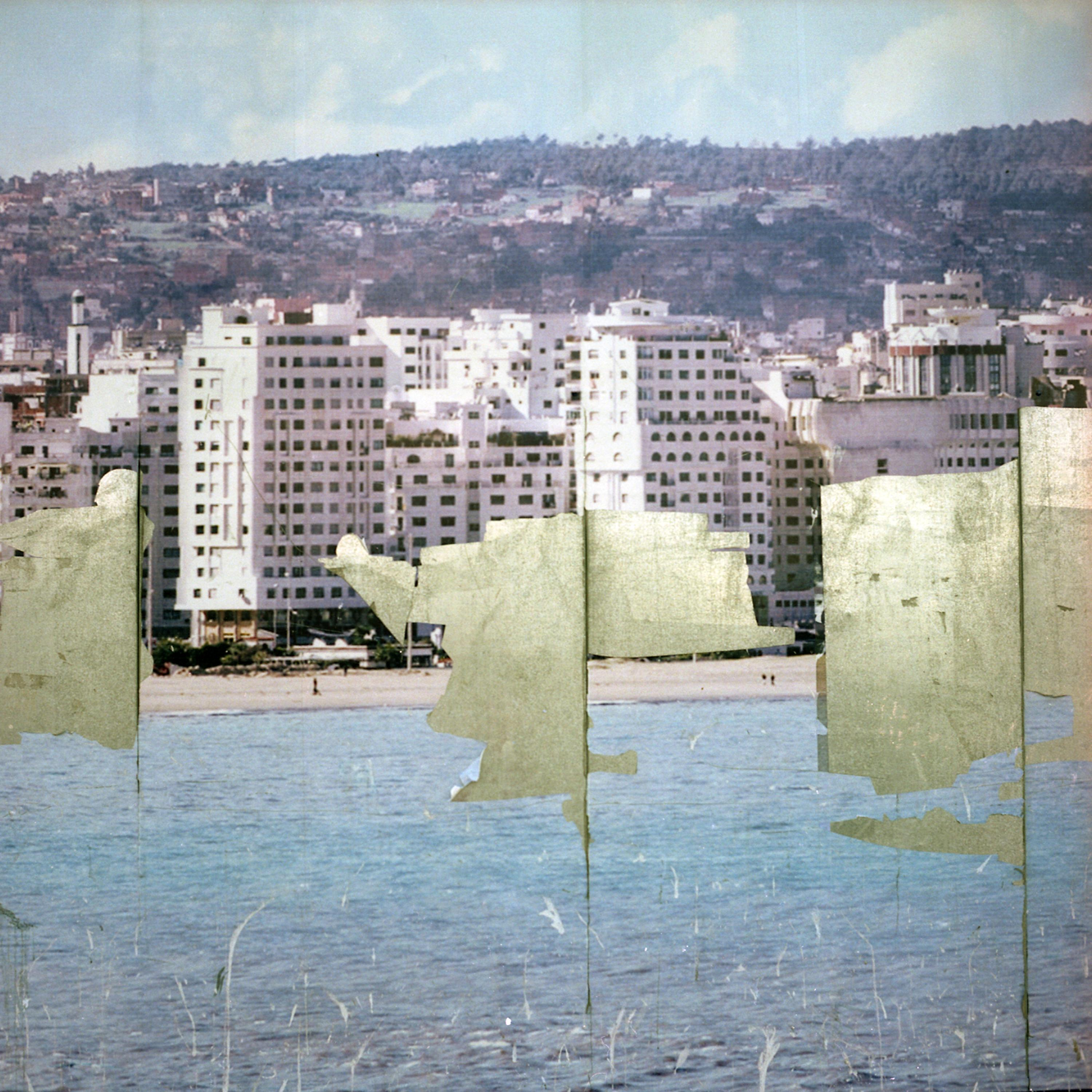What appears to be a faded, scratched poster displaying tall waterfront residential buildings is missing large sections, as if it peeled off of a wall.