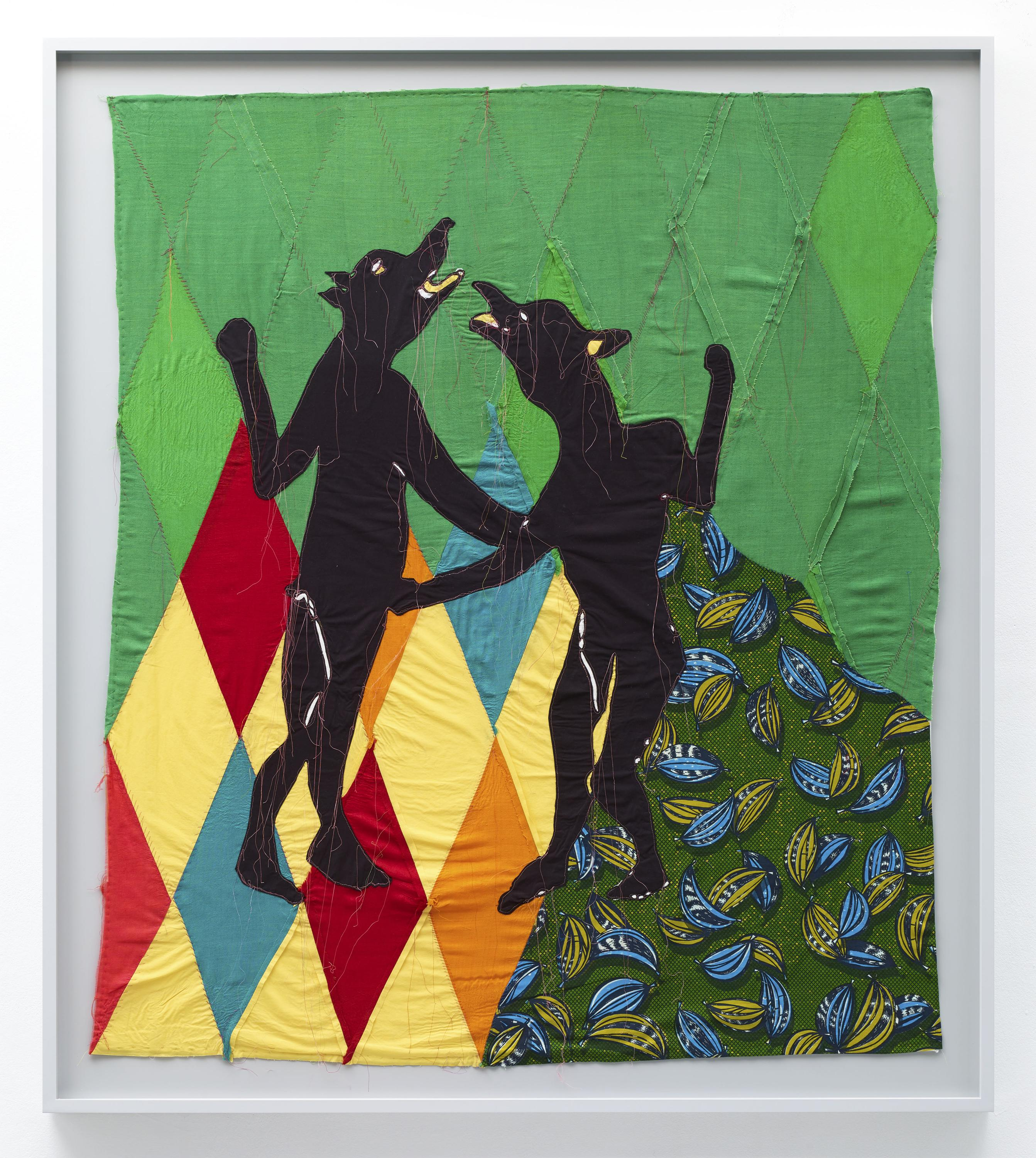 Two black figures with human bodies and dog heads appear on a patterned background of green, red, yellow, orange, and blue diamonds and section of green, light green, and blue-printed fabric.