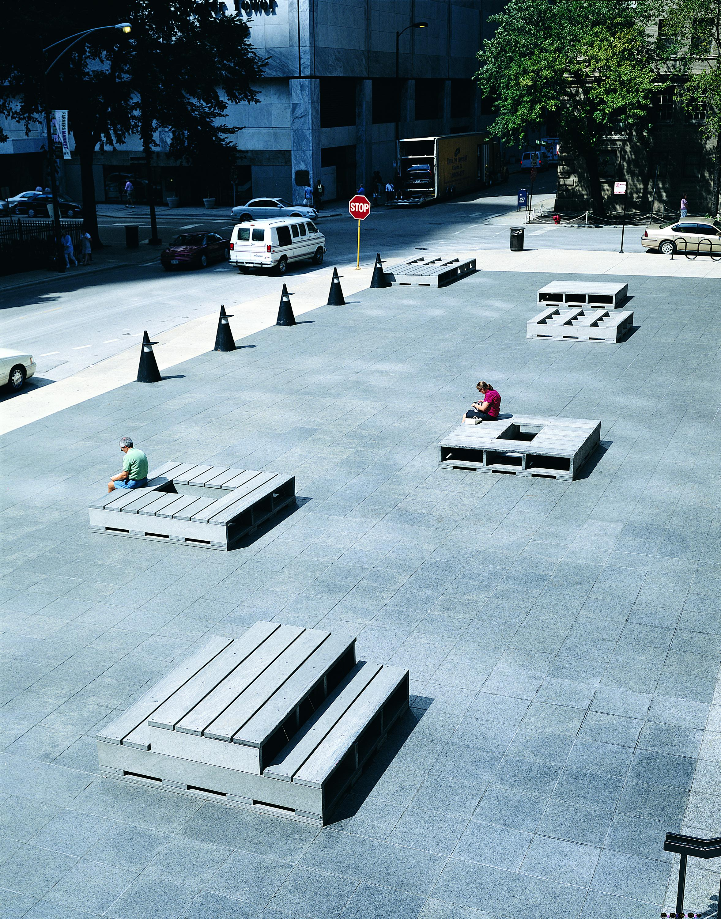 Reprocessed plastic and stainless steel bolts form benches and tables in the MCA plaza