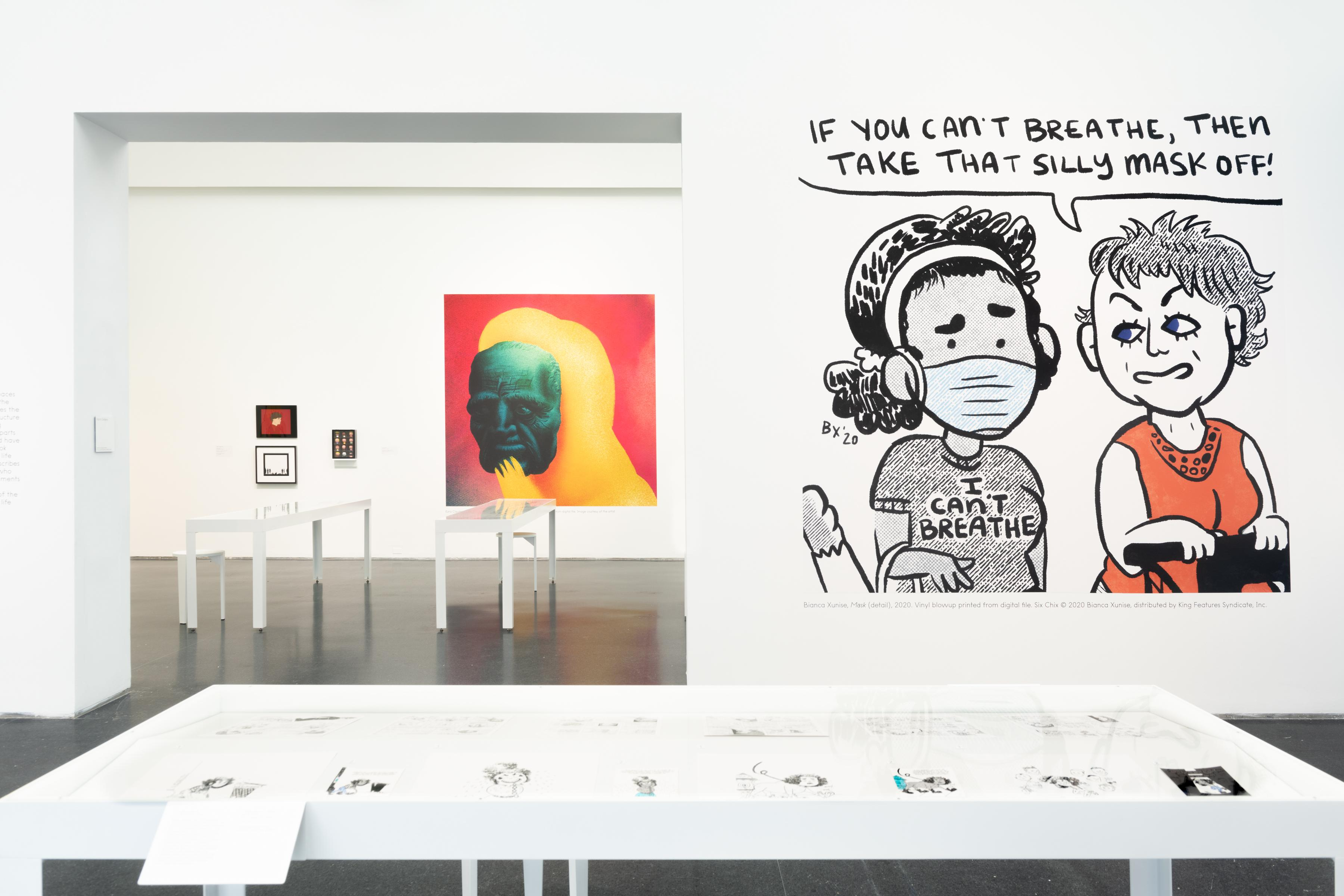 Exhibition interior with comic artwork on walls