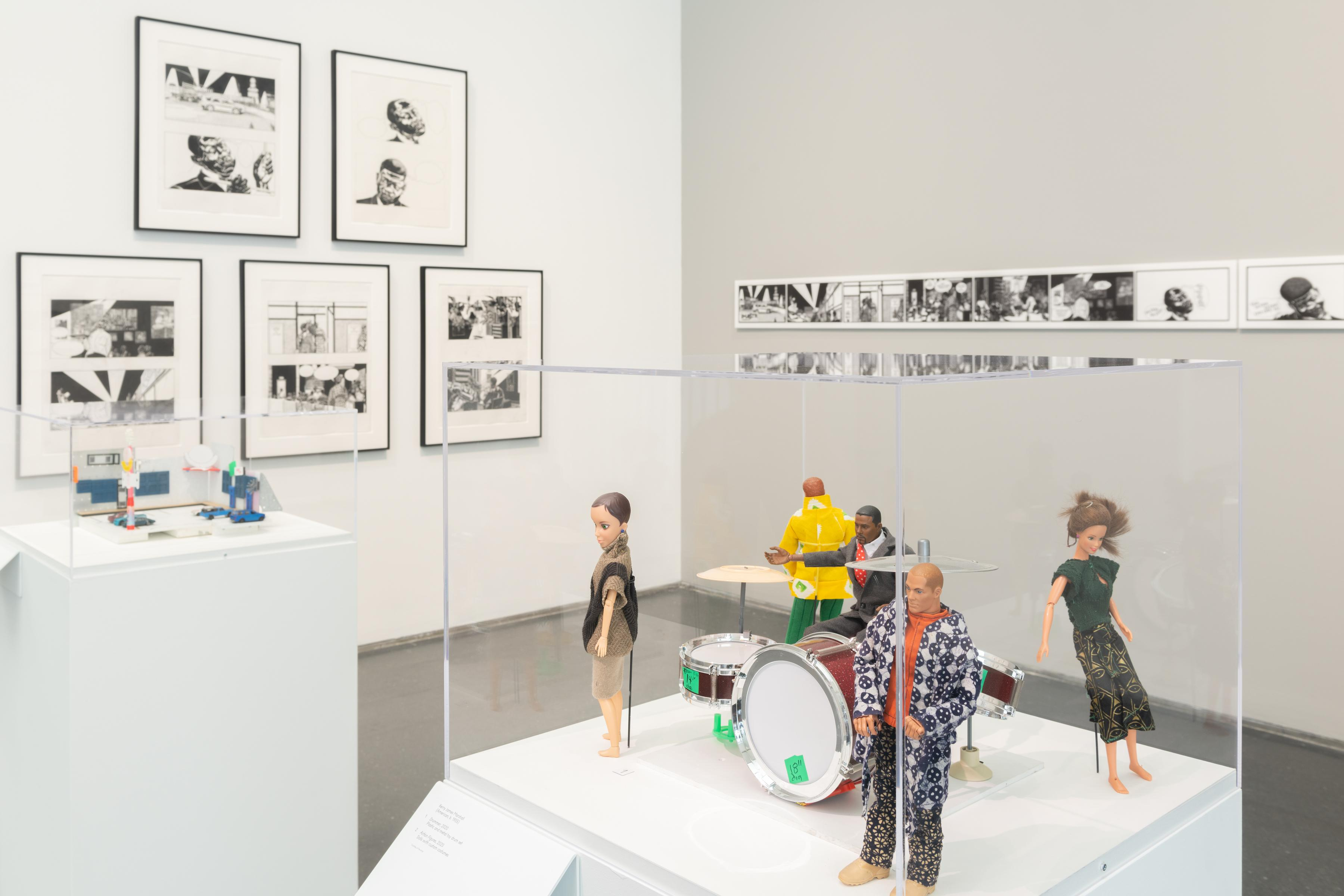 Exhibition interior with toy figurine band in the foreground