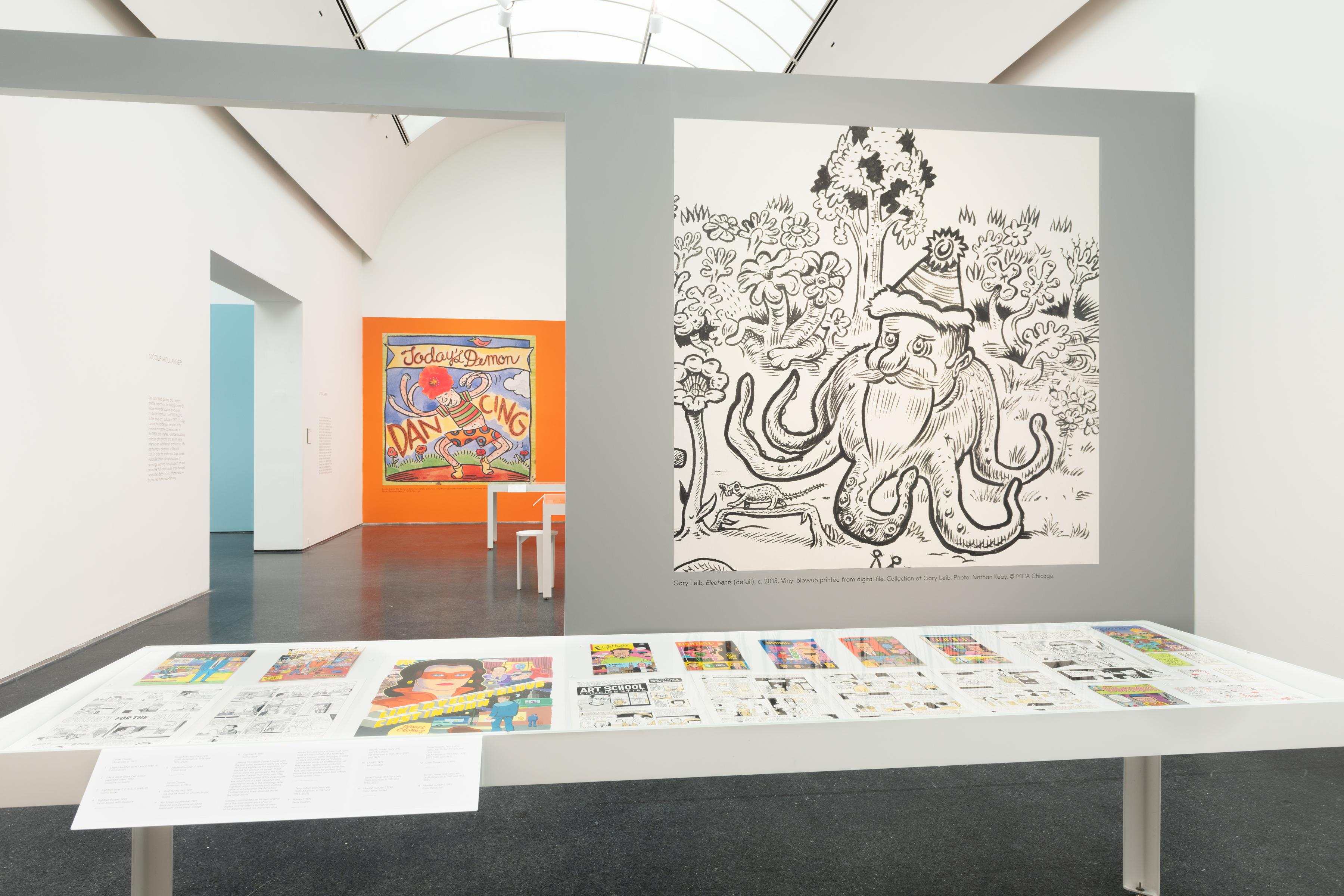 Exhibition interior showing a large line drawing of a Santa Claus octopus